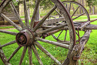 Photograph - Vintage Wooden Wagon Wheel At Mabry Mill by Dan Carmichael