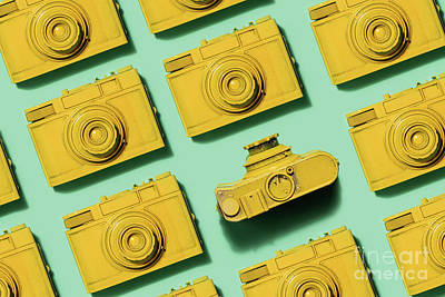 Photograph - Vintage Yellow Cameras Laying On Green Background by Michal Bednarek