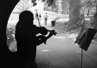 Violinist In Tunnel Print by Dave Beckerman