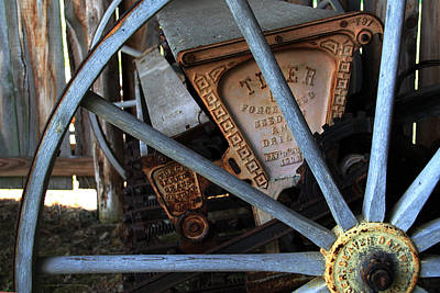 Art Print featuring the photograph Wagon Wheel And Grass Seeder by Joanne Coyle