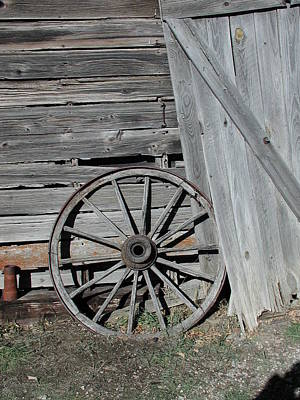 Art Print featuring the photograph Wagon Wheel by Nancy Taylor