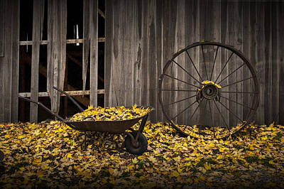 Wheel Barrows Photograph - Wagon Wheel Rim And Wheel Barrel Covered With Fallen Autumn Leaves by Randall Nyhof