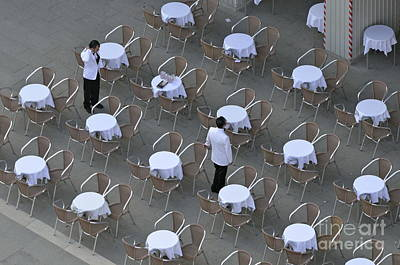 Waiters At Empty Cafe Terrace On Piazza San Marco Art Print by Sami Sarkis