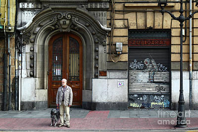 Waiting To Cross The Road In Bilbao Art Print by James Brunker