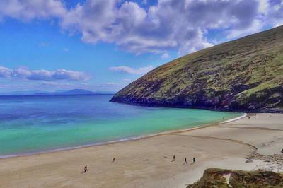 Walkers On Keem Beach, Achill Island Feted By The Green Atlantic Ocean. Art Print by Paul Mc Namara