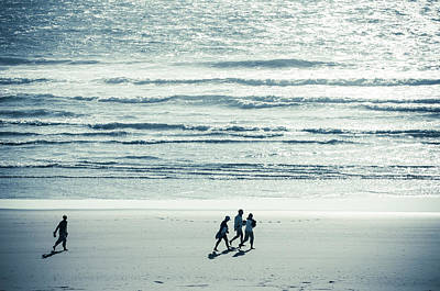 Photograph - Walking Along The Beach by Amyn Nasser