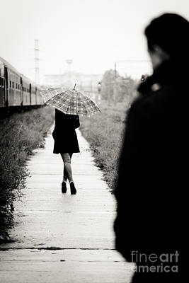Rainy Day Photograph - Walking Away by Gabriela Insuratelu
