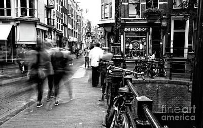 Photograph - Walking In Amsterdam 2014 Mono by John Rizzuto
