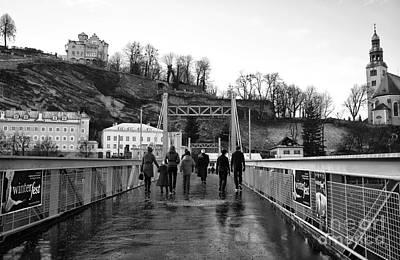 Walking The Bridge In Salzburg Mono Art Print by John Rizzuto