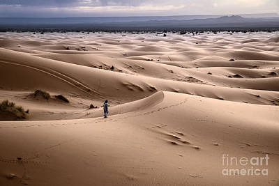Sand Dunes Photograph - Walking The Desert by Yuri Santin