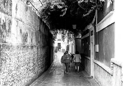 Photograph - Walking The Old Streets Of Seville by John Rizzuto