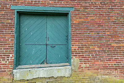 Photograph - Warehouse Loading Door And Brick Wall by George Sheldon