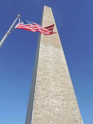 Travel Rights Managed Images - Washington Monument and US Flag Royalty-Free Image by Doug Swanson