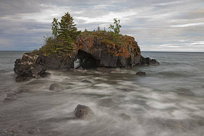 Photograph - Water Coming Into Shore Around A Rock by Susan Dykstra