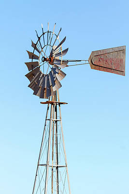 Rural Photograph - Water Pump Windmill On Blue Sky Background by David Gn