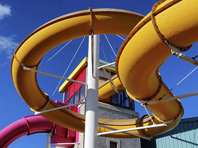 Photograph - Water Slides At Bundoran Waterworld - Abstract, Bright Primary Colours Against A Deep Blue Sky by John Carver