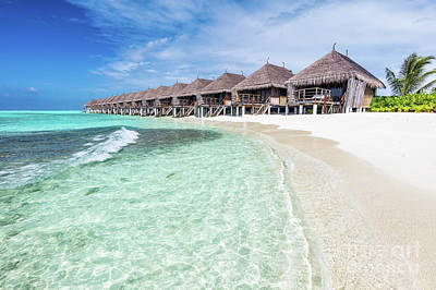 Photograph - Water Villas In A Row By The Seashore On Maldives Tropical Resort by Michal Bednarek