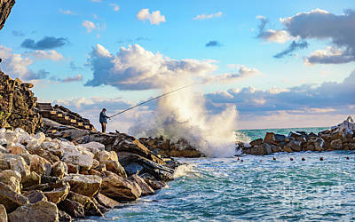 Photograph - Waves Crashing And Fisherman On The Rocks Of Riomaggiore In Cinque Terre, Italy by Global Light Photography - Nicole Leffer