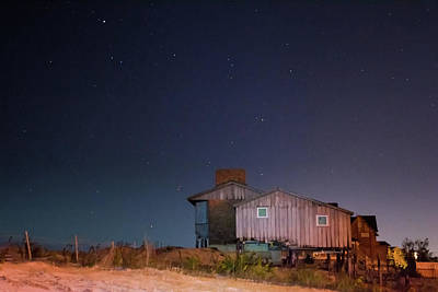 Saltlife Photograph - Weather Worn Beach House Against Starry Midnight Blue Sky by Tim Bond