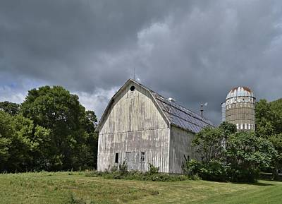 Photograph - Weathered Barn And Silo Under A Cloudy Sky by Steven Liveoak