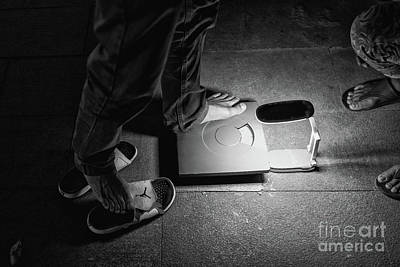 Photograph - Weighing by Dean Harte