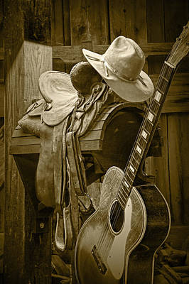 Photograph - Western Country 6 String Acoustic Guitar In Sepia Tone With Horse Saddle by Randall Nyhof