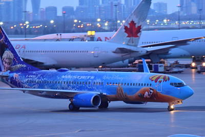 Photograph - Westjet Disney Frozen Airplane by Puzzles Shum