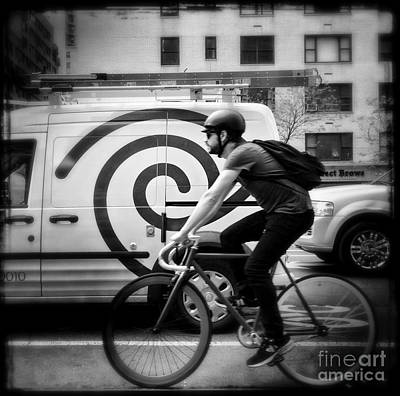 Photograph - What Goes Around - Man On A Bike by Miriam Danar