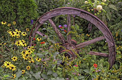 Photograph - Wheel And Flowers by Larry Bishop