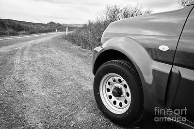 Wheel Of Small 4x4 Vehicle Driving On Gravel Road Onto Main Road Reykjavik Iceland Art Print
