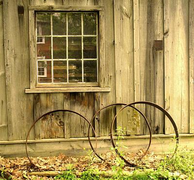 Photograph - Wheel Rims by Ian  MacDonald