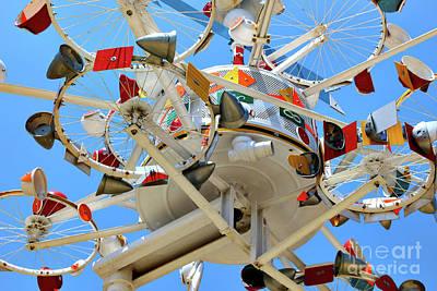 Vollis Simpson Photograph - Whirligig Wheels by Mylinda Revell