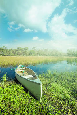 Photograph - White Canoe In The Mists Of Morning by Debra and Dave Vanderlaan