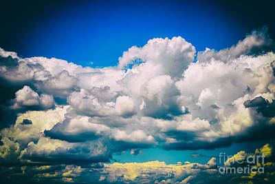 Grey Clouds Photograph - White Cumulus Clouds And Grey Storm Clouds Gathering On Blue Sky by Radu Bercan