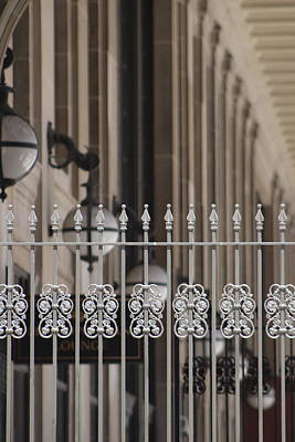 Food And Flowers Still Life Rights Managed Images - White Wrought Iron Gate in Chicago Royalty-Free Image by Colleen Cornelius