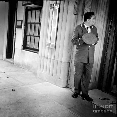 Photograph - Who's That - Doorman In New York by Miriam Danar