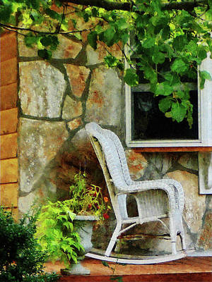 Rocking Chair Photograph - Wicker Rocking Chair On Porch by Susan Savad