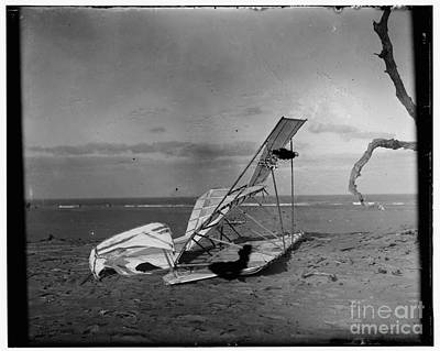 Photograph - Wilbur And Orville Wright Crumpled Glider Wrecked By The Wind On Hill Of Wreck Named After Shipwreck by R Muirhead Art