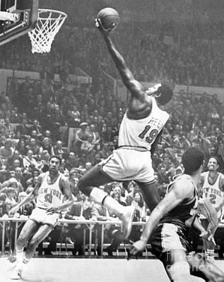 Willis Reed Soars Over Wilt Chamberlain For A Basket. 1970 Art Print