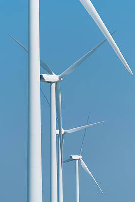 Photograph - Wind Turbines Against Blue Sky by Hans Engbers