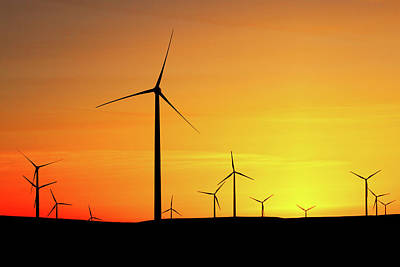 Spinning Photograph - Wind Turbines Silhouette by Todd Klassy