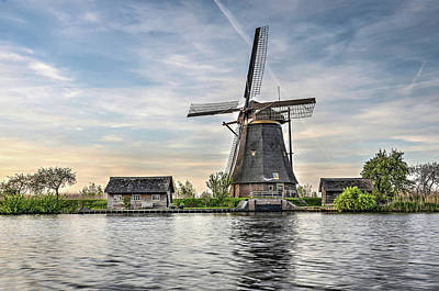 Photograph - Windmill And Canal In Kinderdijk by Frans Blok
