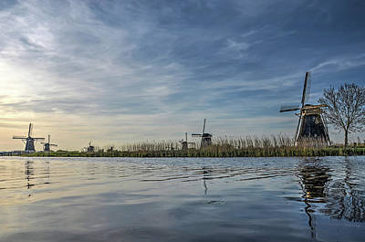 Photograph - Windmill Reflecting In Kinderdijk Canal by Frans Blok