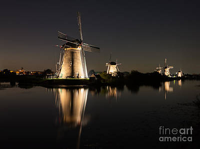 Windmills Illuminated At Night Art Print
