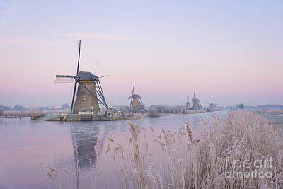 Photograph - Windmills In The Netherlands In The Soft Sunrise Light In Winter by IPics Photography