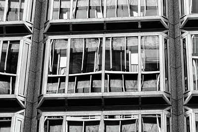 Photograph - Windows On A Multi-storey Building Showing Reflections Bw by Jacek Wojnarowski