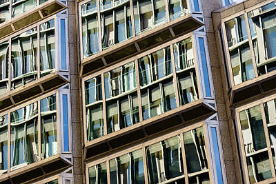 Photograph - Windows On A Multi-storey Building Showing Reflections by Jacek Wojnarowski