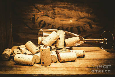 Wine Glass With An Assortment Of Bottle Corks Art Print