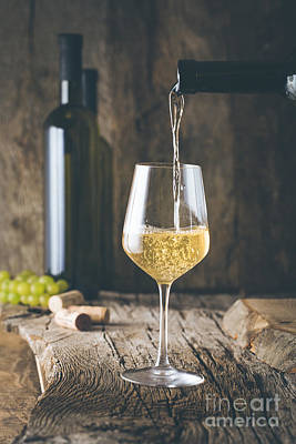 Pouring Wine Photograph - Wine In Glass by Mythja Photography
