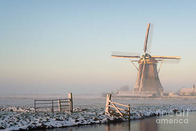 Photograph - Winter Landscape In The Netherlands With A Windmill At Sunrise by IPics Photography